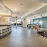 Holiday Inn Express & Suites Yosemite Pk Chowchilla lobby area and front desk